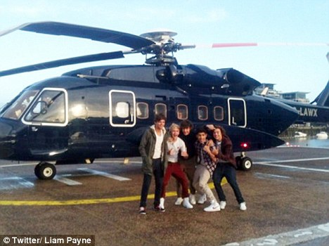 Flying high: The boys made their way around the country in a luxury private helicopter