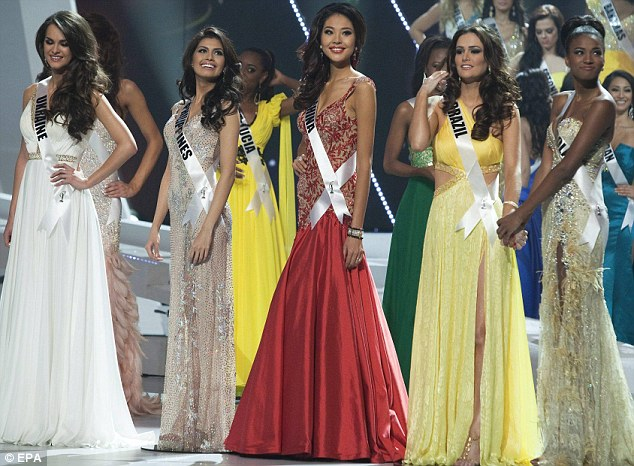 Top five: Miss Universe, Ukraine's Olesya Stefanko, the Philippines' Shamcey Supsup, China's Luo Zilin, Brazil's Priscila Machado and Angola's Leila Lopes pose during the ceremony of coronation of Miss Universe 2011