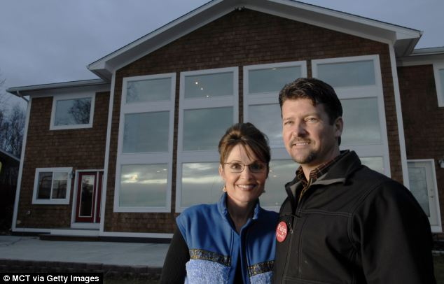 Broken home? Sarah Palin poses with husband Todd Palin outside their house in Wasilla, Alaska, in October 2006