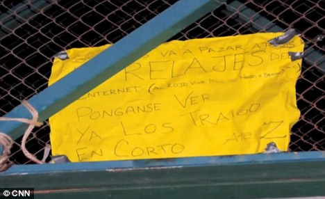 This sign was left on the bridge, translated from Spanish: 'This is going to happen to all those posting funny things on the internet'