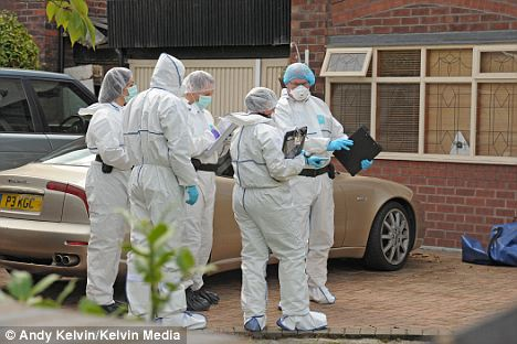Investigation: Police forensic investigators outside the home in Bramhall, Greater Manchester, where a suspected intruder died of knife injuries after an attempted burglary