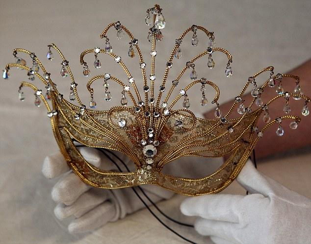Masquerade: An fancy dress item worn by Princess Margaret in gold brocade, decorated with crystals