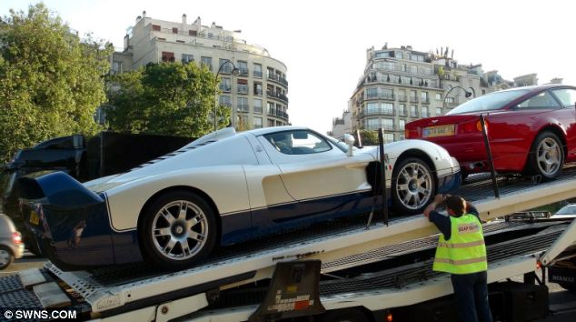 Away we go: Among the 11 supercars siezed were Maseratis, two limited edition Bugatti Veyrons, Ferraris, Porsches and Rolls Royces