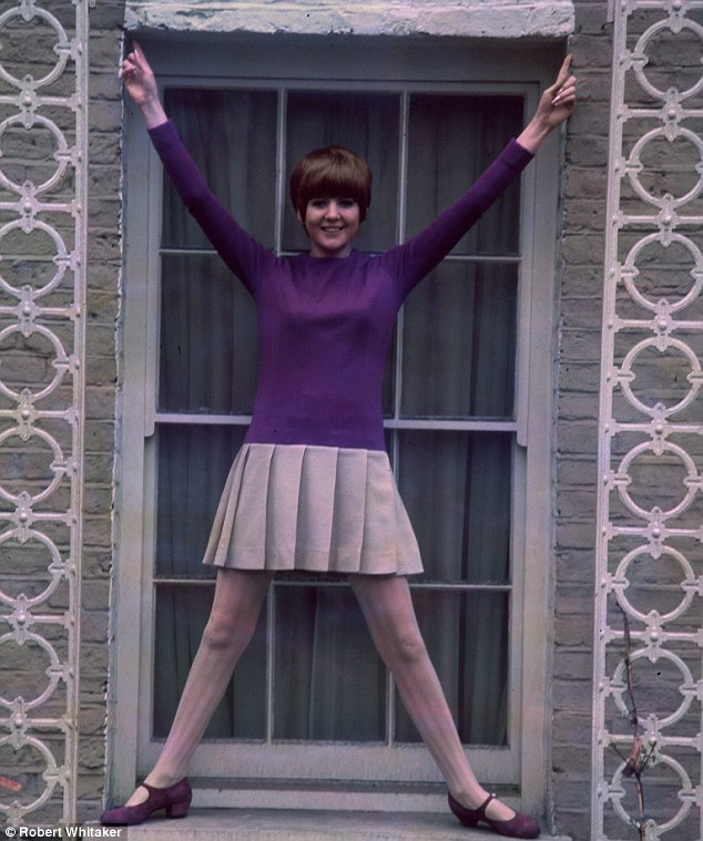 Rising star: Whitaker was also asked to photograph other pop stars during the 1960s. Here a young Cilla Black poses for the camera