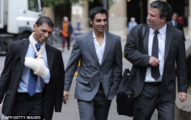 Mr Butt (centre) arriving at court earlier today. His contract was read out that said cricketers must immediately notify their manager and captain if they are approached by anyone who asks them to fix a match