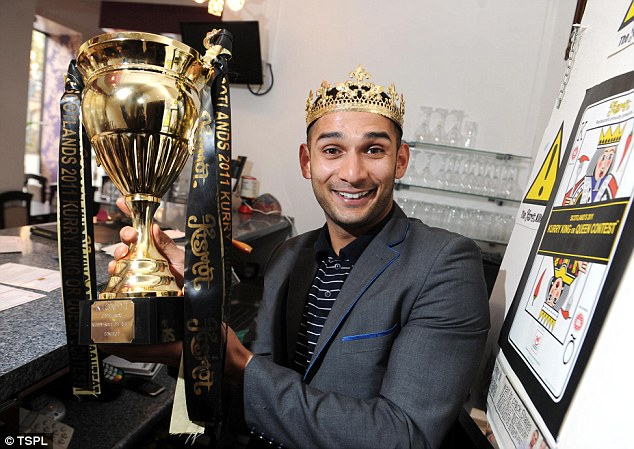 Prize: Manager Abdul Ali poses with the Kurry King or Queen crown and trophy