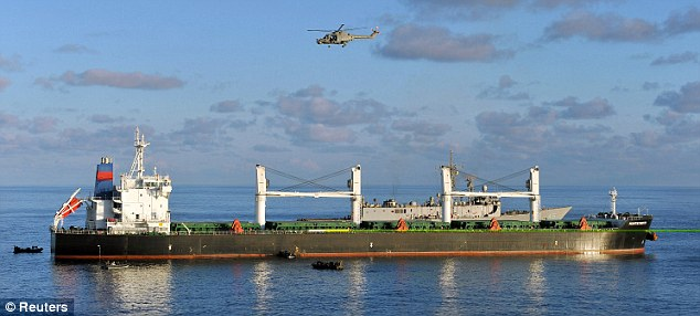 A helicopter hovers above the Montecristo during the operation in the Indian Ocean