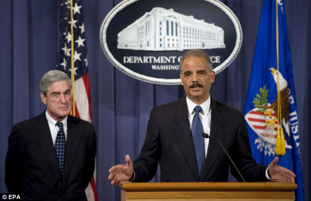 Attorney General Eric Holder, right, and FBI Director Robert Mueller announce that two individuals have been charged for their alleged participation in a plot to murder the Saudi Ambassador