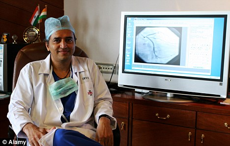 High tech: Dr Devi Shetty sits in front of a high definition monitor showing part of a patient seeking treatment from the country side - thanks to 'tele-medicine'