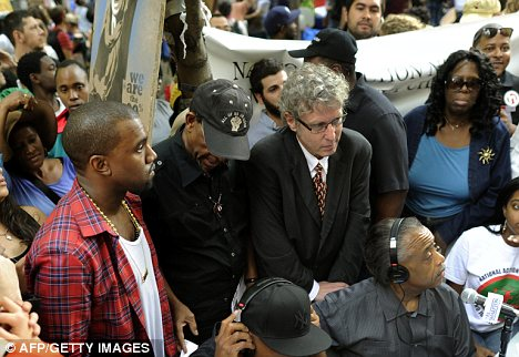 Solidarity: Singer Kanye West joined with demonstrators at the Occupy Wall Street movement - which is drawing attention to corporate greed and corruption