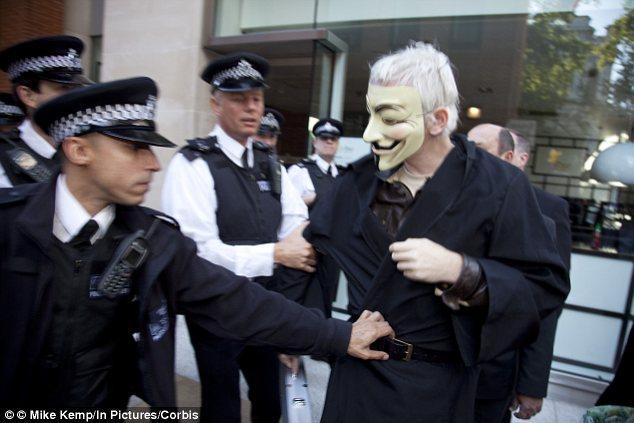 Wikileaks founder Julian Assange wears Guy Fawkes mask at Occupy London demo