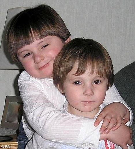 Tragic: Lewis Jenkins with his younger brother Taylor before they were both killed when a fire ripped through their house
