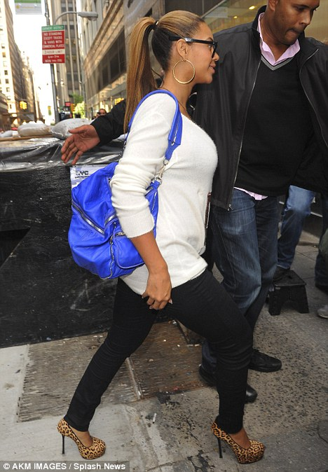 Bump chic: The singer, seen today in New York, looked casual in a sweater and dark jeans