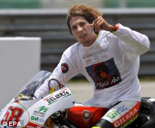 Marco Simoncelli celebrating after taking the 2008 world championship title