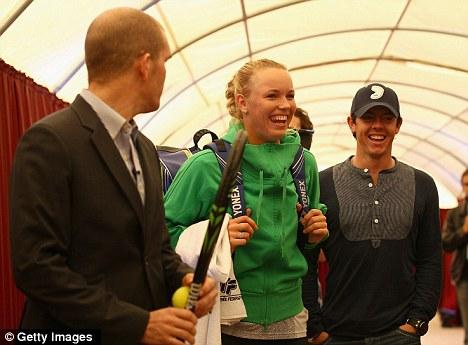 Golden couple: Caroline Wozniacki (centre) and Rory McIlroy (right) in Turkey