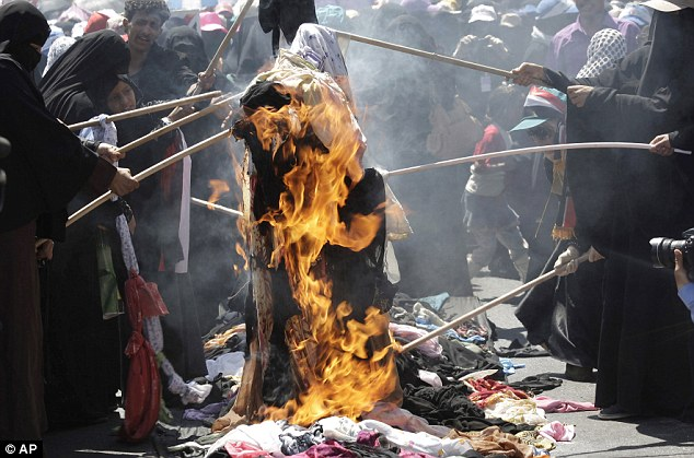 Protesting: Yemeni women burn their veils during a demonstration demanding the resignation of President Ali Abdullah Saleh in Sanaa