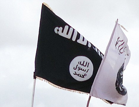 The Al-Qaeda flag was seen above Benghazi's courthouse just days after Libyan rebels imposed Sharia law on parts of the country (file picture)