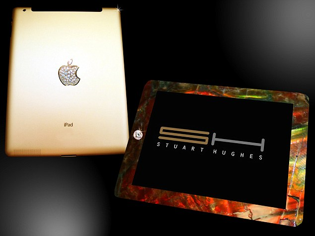 The £5,000,000 iPad Gold History is crusted with gold, and precious stones mixed with 'shavings' from a T-Rex's leg bone - and comes in a limited edition of just two