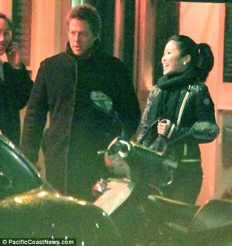Brief affair: Hugh and Miss Hong on a night out in London in April
