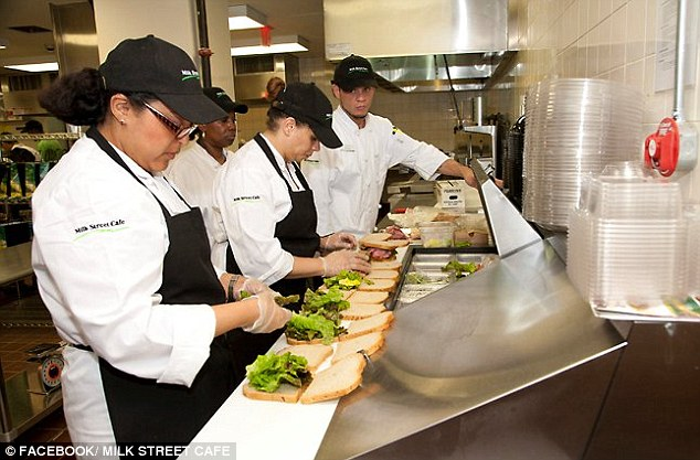 Out of work: Employees craft sandwiches behind the counter at the cafe, where 21 of 100 have been let go
