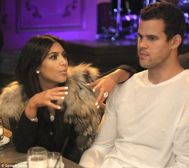Gone in 72 days: Kim with Kris Humphries - and her ring - at her 31st birthday celebration in New York last month