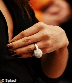 Something to tell us: The model sported a huge ring on her left hand