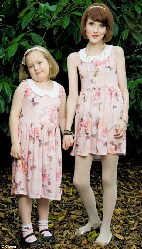 Anorexic mother Rebecca Jones, right, who weighs less than her seven year old daughter Maisy, left