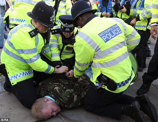 Tough: Police were trying to ensure that protesters kept on the approved route of the march