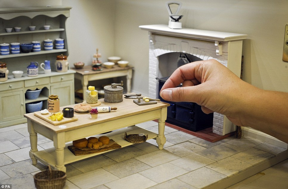 kitchen miniature carts with seating marvellous miniatures on display in a doll s house daily mail online hands reach for butter pat scene at the shop