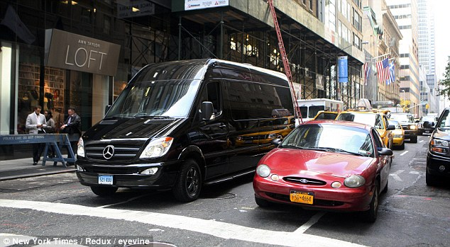 Eye-catching: Although the luxury is hidden on the inside of the van, the 22ft-long vehicles do not escape notice. The most popular model is a Mercedes, such as this Mercedes-Benz Sprinter van driving in New York