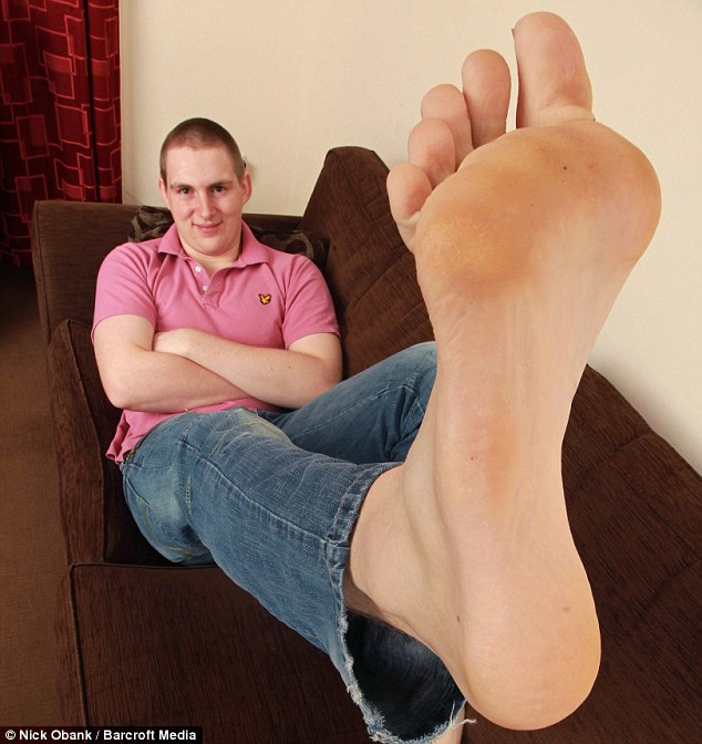 In a league of his own: Carl Griffiths, 19, has Britain's biggest feet and wears a size 21 shoe