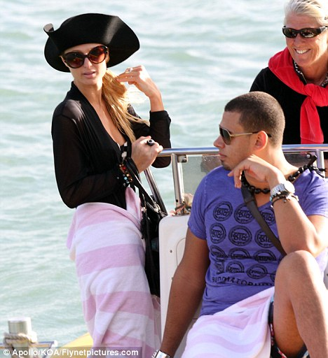 New love? Paris and rumoured new love interest Dutch DJ Afrojack were spotted sailing around the surrounding the island of Maui on Tuesday