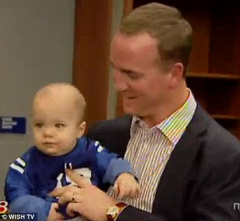 Little Manning: Peyton and his son Marshall talk to reporters after the Indianapolis Colt lost to Carolina on Sunday in Lucas Oil Stadium