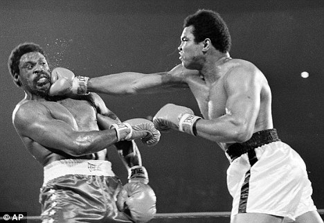 Competition: Muhammad Ali hits Ron Lyle, left, with a hard right to the chin during the title bout in Las Vegas, Nevada, in 1975. Lyle died last Saturday