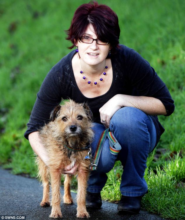 Owner Nicky Harwood is reunited with seven-year-old Bilbo who get wedged chasing a rabbit down a 10-inch wide hole in Dobwalls, Cornwall.