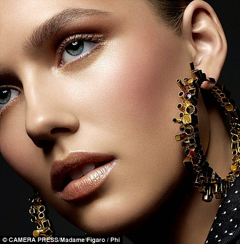 Beware big earrings: Heavy jewellery could stretch your ear lobes (posed by model)