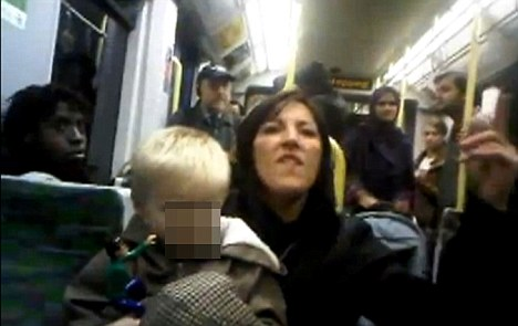 Racist rant: Police took Emma West into custody after a video (pictured) appeared on the internet showing a woman apparently abusing tram passengers