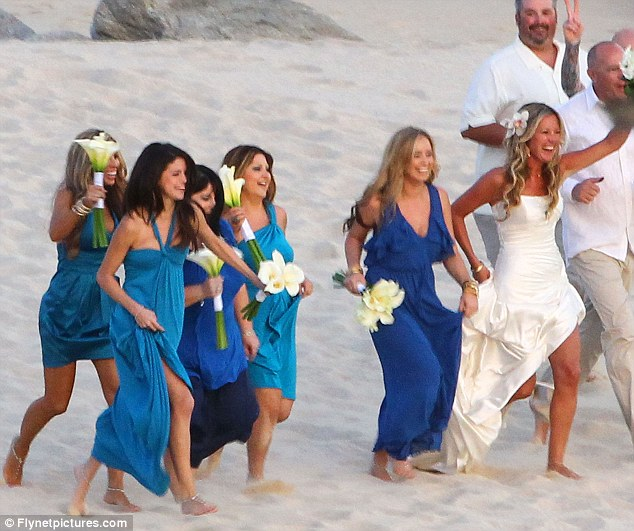 Bridesmaid patrol: Selena and her fellow bridesmaids all wore different shades of blue