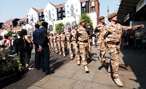 Officers prevented Jules Mattsson - then 15 - from taking pictures at a military parade in Romford, east London, in June 2010, pictured