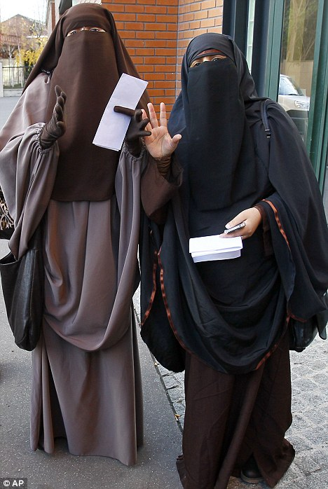 Facing jail: Hind Ahmas, left, could be sentenced to two years in prison for wearing a banned Islamic head covering in France
