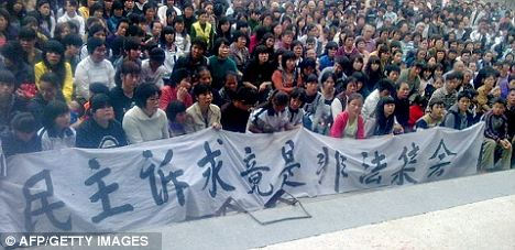 Thought crime: Wukan residents carrying a banner saying 'democratic appeal can hardly be illegal rally' during a protest, in this picture released today