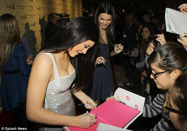 Excited: Kylie and Kendall spent time meeting and greeting their fans outside the event before heading inside