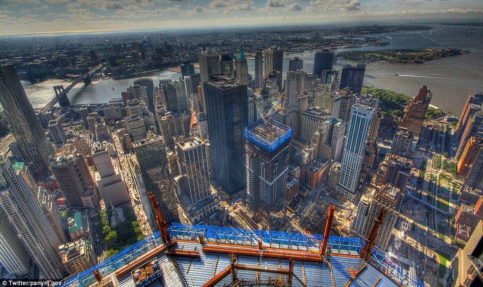 Breathtaking: Looking east from the 77th floor as construction work carries on below