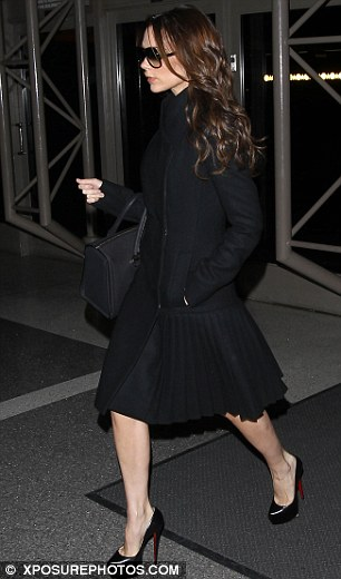 Black to basics: Victoria was a chic sight in head-to-toe obsidian, save for the red soles of her Louboutins