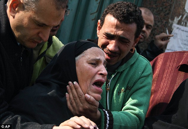 Grief: A woman mourns slain Egyptian protesters who were killed during the latest clashes with Egyptian soldiers, while they wait to receive their bodies in front of the morgue in Cairo