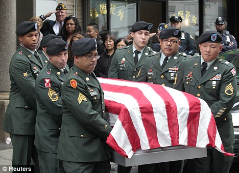 Grieving: The casket of Private Danny Chen is carried by an honour guard during a funeral procession in New York two months ago