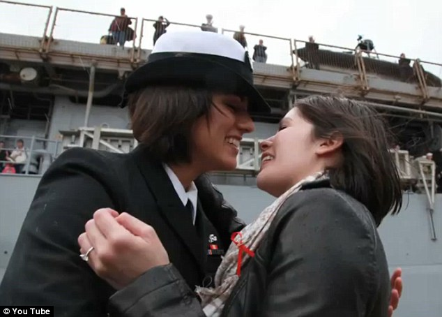 Navy first: The crown scream and waved flags as the couple, Petty Officer 2nd Class Marissa Gaeta and Petty Officer 3rd Class Citlalic Snell made military history