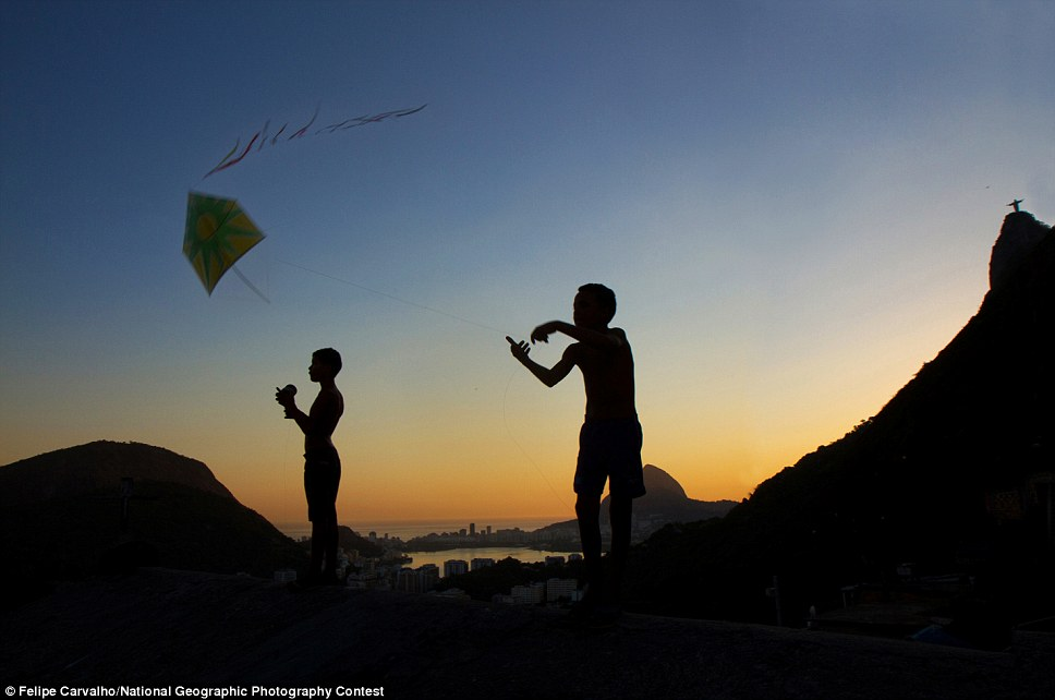 Flying: Flying Kites, by Felipe Carvalho, received honorable mention for its capture of a kite battle at the Santa Marta ghetto in Rio de Janeiro which for many years were used to alert drug dealers of approaching enemies