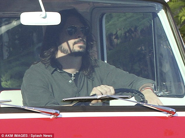 Dave Grohl Cruises Around Beverly Hills In A Vintage Red