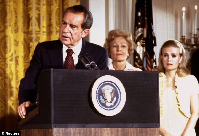 President Richard Nixon (left) says goodbye to family and staff in the White House East Room on August 9, 1974